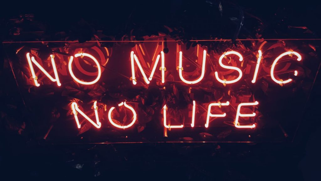 """sign that says, """"no music, no life"""""""